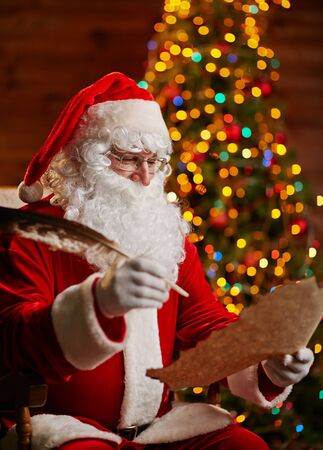 answering: Santa Claus with feather answering Christmas letter