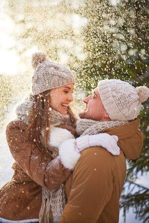 amorous woman: Amorous man and woman enjoying snowfall