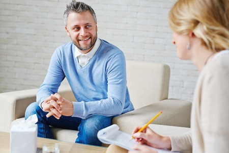 Happy patient talking to psychologist