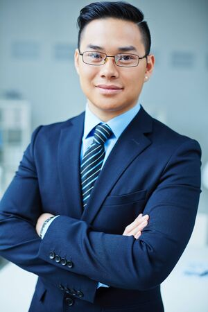 formalwear: Successful Asian businessman in formalwear looking at camera