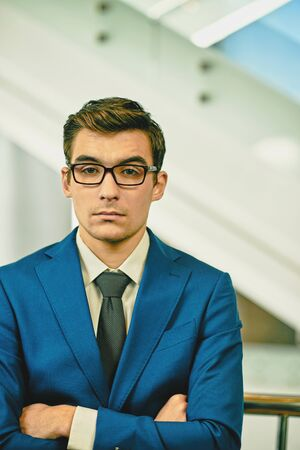 formalwear: Serious employee in formalwear and eyeglasses looking at camera Stock Photo