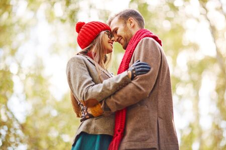 couples hug: Affectionate couple in stylish casualwear embracing in park Stock Photo