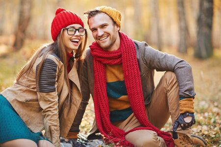 affectionate: Affectionate young dates laughing during rest in park Stock Photo