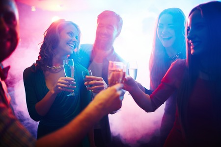 clubber: Group of happy friends with champagne having fun at party Stock Photo