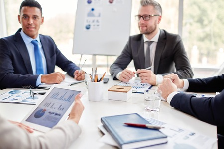 Business team gathered by workplace for consultation Stock Photo