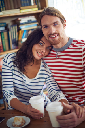 amorous: Amorous sweethearts sitting in cafe Stock Photo