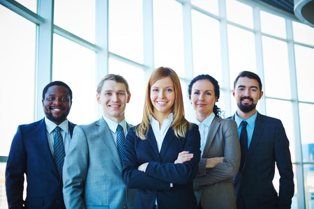 work group: Successful business partners looking at camera with smiles