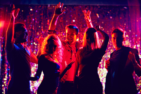 dancing club: Group of young people dancing in the night club Stock Photo
