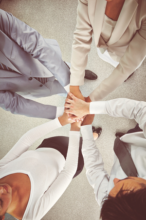 team hands: Group of colleagues making pile of hands