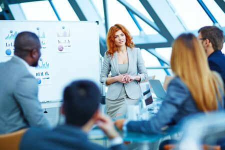 business conference: Pretty manager listening to colleagues after explanation of her idea
