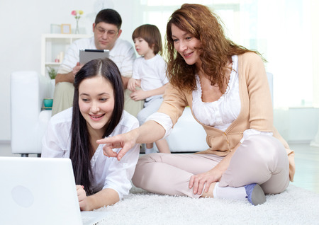 happy teenagers: Happy woman with daughter networking on background of man and little boy