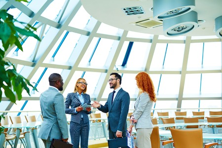 teamwork business: Group of modern employees interacting in office