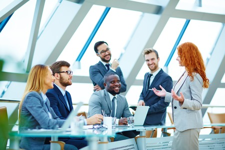 corporate team: Modern employees voicing their opinions upon new ideas