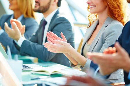 happy businesswoman: Row of colleagues applauding to speaker at seminar Stock Photo