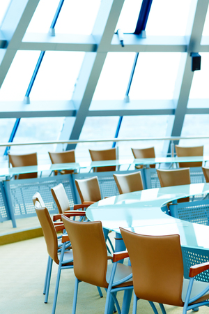 halls: Empty conference hall with round table and chairs around it Stock Photo
