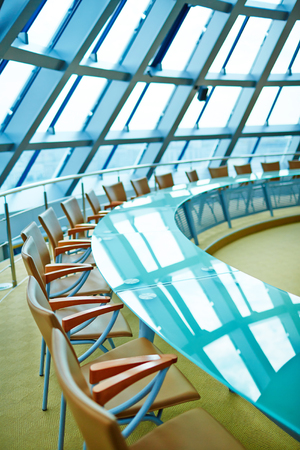 in the floor: Empty conference hall for meetings and trainings with large round table and chairs around it Stock Photo