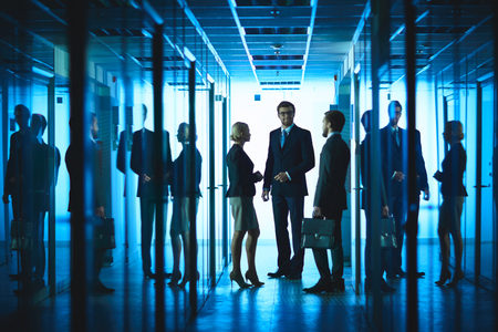 business people meeting: Group of business people having meeting in corridor of business center Stock Photo