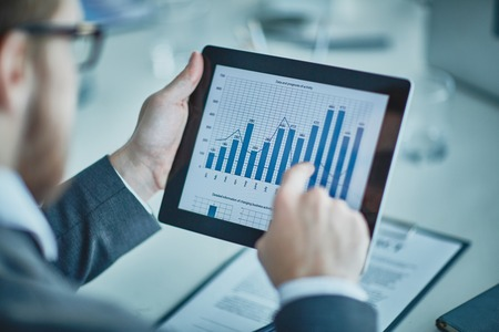 graph: Businessman analyzing chart and graph showing changes on the market