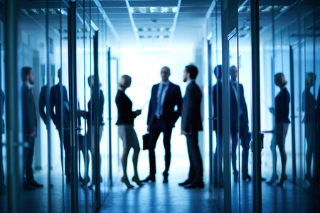 blurred people: Group of co-workers interacting in corridor between offices