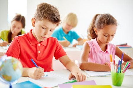 pupils: Clever pupils drawing at lesson
