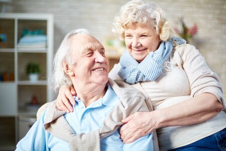 couple relaxing: Cheerful elderly couple relaxing at home Stock Photo