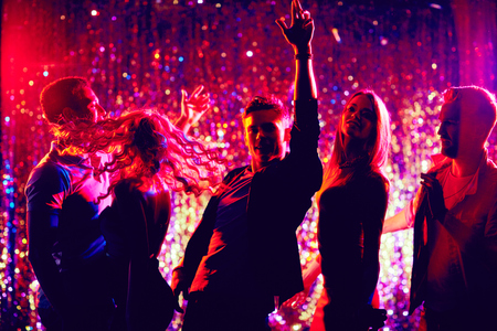night club: Dancing friends enjoying party in the night club