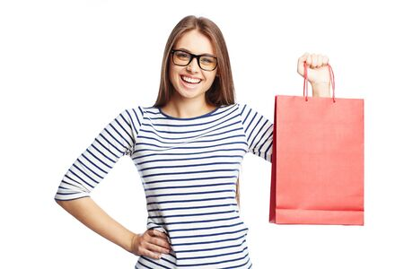 paperbag: Happy female with red paperbag looking at camera