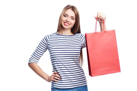 paperbag: Young shopper with red paperbag looking at camera