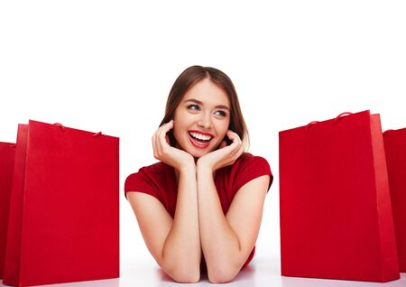 paperbags: Modern shopper lying between red paperbags