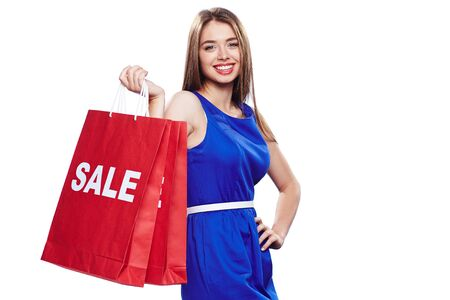 paperbags: Elegant female in blue dress holding two paperbags Stock Photo