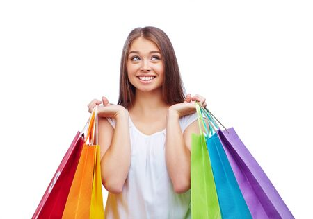 shopper: Female shopper with several paperbags after shopping