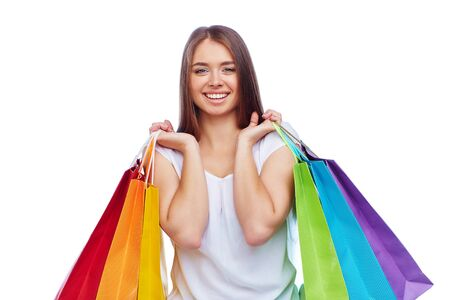 happy customer: Young smiling consumer carrying paperbags Stock Photo