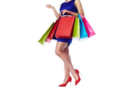 paperbags: Legs of pretty woman in blue dress with paperbags