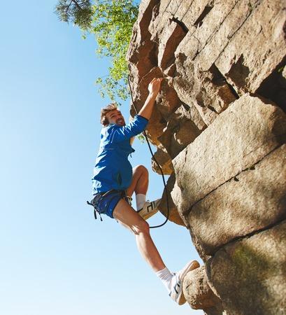 rock climbing man: Rappeling lover climbing the rock
