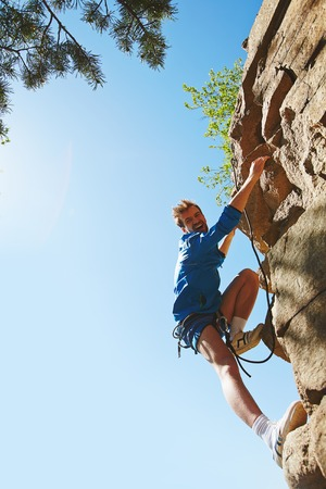rappeling: Rappeling lover reaching cliff of mountain