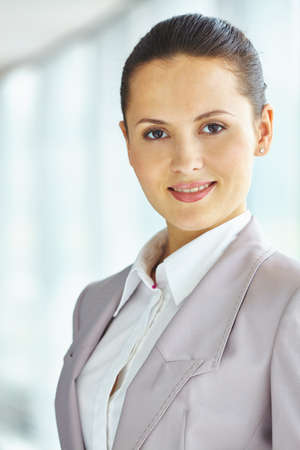 woman portrait: Pretty young businesswoman in formalwear looking at camera Stock Photo