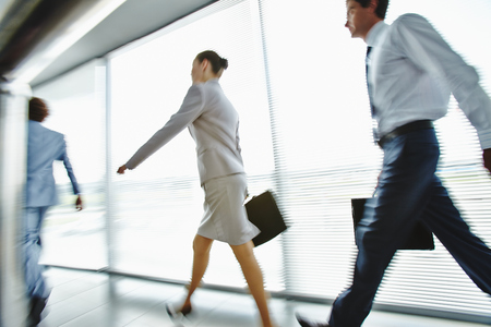 going: Busy employees moving for work in the morning Stock Photo