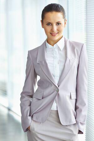 formalwear: Pretty employee in formalwear looking at camera Stock Photo