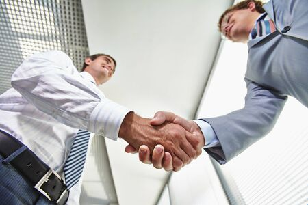 handshaking: Two businessmen handshaking after signing contract Stock Photo