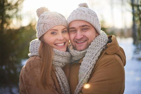 boy lady: Joyful sweethearts in winterwear looking at camera outdoors