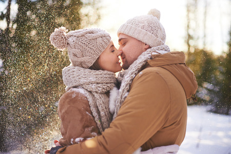 amorous woman: Amorous man and woman kissing on winter day