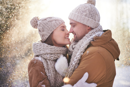 couple winter: Happy young couple flirting on winter day Stock Photo