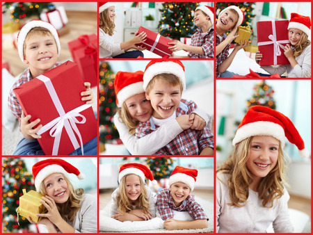 Happy kids in Santa caps staying at home on Christmas evening Stock Photo