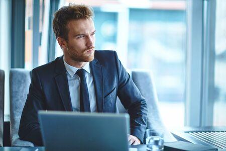 one man: Handsome businessman planning work in office Stock Photo