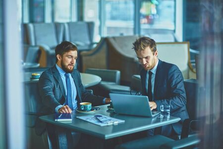 employee: Young employees working upon project in office
