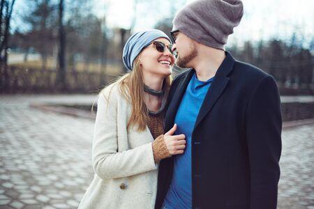 urban environment: Happy dates having walk in urban environment
