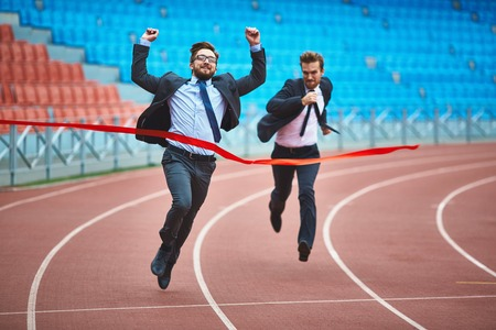 winning idea: Successful young businessman winning the race