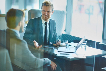 colleagues: Happy employee discussing idea to colleague in office