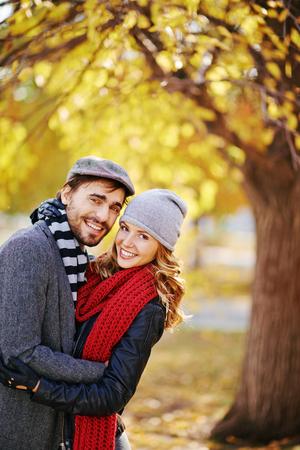 natural looking: Amorous couple looking at camera in natural environment Stock Photo