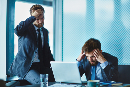 young business man: Male employees trying to find out solution of problem